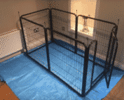 a dog pen, used for a dog recovering from a spinal operation